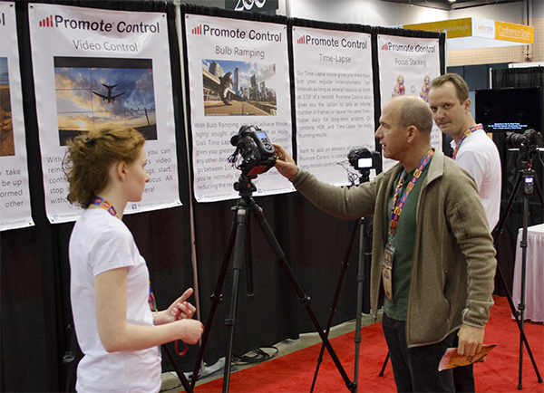 Instructor Joel Grimes checks out new equipment on the expo floor.