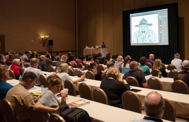 """Pete Collins shows off one of his great Photoshop Illustrations in the """"Photoshop for Beginners"""" workshop."""