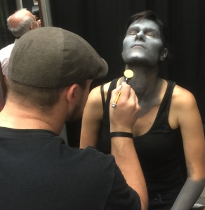 Rayce Bird applying makeup effects to Maria.